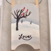 Love wooden sled ornament