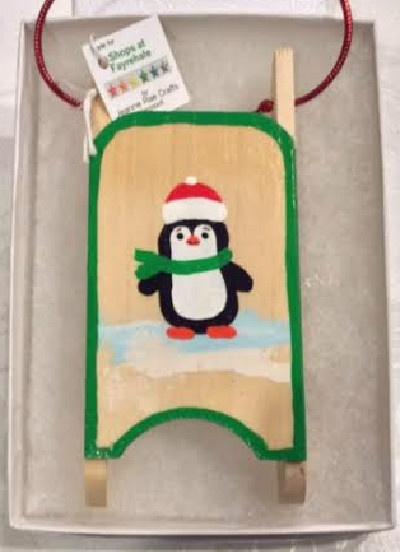 Penguin sled ornament
