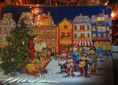 5.) — Santa and Carolers Advent Calendar ($4.95)