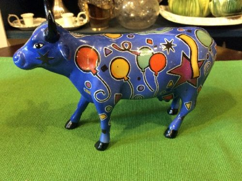 """""""Party Cow"""" - Westland Cow Parade Ceramic Figurine - """"With a moo moo here And a moo moo there Here a moo, there a moo Everywhere a moo moo"""""""
