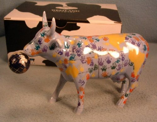 """It's A Smool World"" - Westland Cow Parade Ceramic Figurine - ""With a moo moo here, And a moo moo there, Here a moo, there a moo, Everywhere a moo moo"""